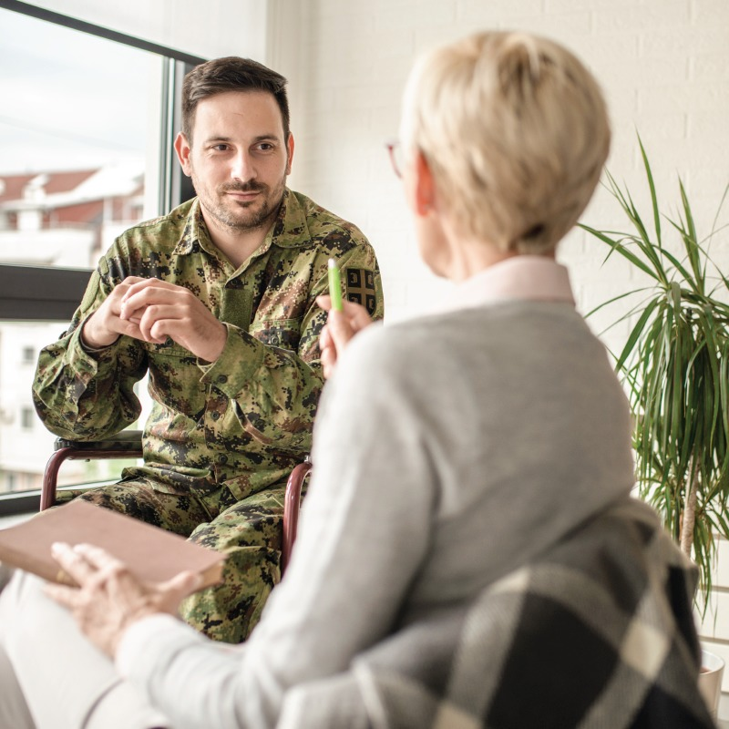 Male military veteran in therapy session with female psychologist